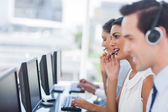 Focus of smiling call centre agent — Stock Photo
