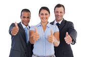 Group of smiling business showing their thumbs up — Stock Photo