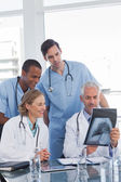 Medical team examining radiography — Stock Photo