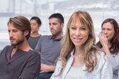 Patients listening in group therapy with one woman smiling — Stock Photo