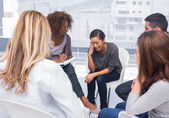 Woman getting distressed in group therapy — Stock Photo