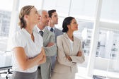 Confident business looking at the same way — Stock Photo