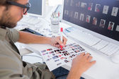 Photo editor marking the contact sheet — Stock Photo