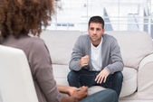 Sad man speaking to a therapist — Stock Photo