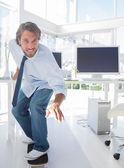 Employee skating through his office — Stock Photo