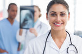 Smiling doctor standing in a bright hospital — Stock Photo