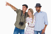 Photographer pointing to something with friends — Stock Photo