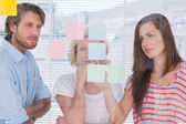 Colleagues looking at the planning — Stock Photo