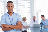 Smiling doctor with arms crossed — Stock Photo