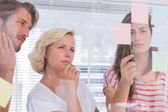 Colleagues looking doubtful — Stock Photo