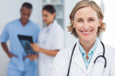 Smiling woman doctor looking at the camera — Stock Photo