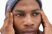 Man in beanie hat looking unhappy — Foto Stock