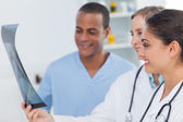 Medical team analysing a radiography — Stock Photo