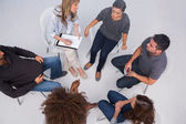 Patients listening to each other in group session — Stock Photo