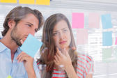 Colleagues watching sticky notes — Stock Photo