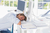 Man asleep at his desk — Stock Photo