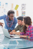 Creative team working together on laptop — Stock Photo