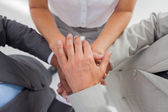 Business gathering their hands together — Stok fotoğraf