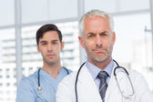 Two serious doctors standing — Stock Photo