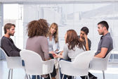 Patients around therapist in group therapy session — Stock Photo