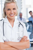 Young nurse with arms crossed — Stock Photo