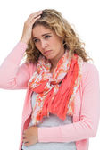 Blonde woman having both headache and belly pain — Stock Photo