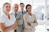Smiling business standing together — Stock Photo