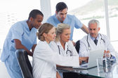 Serious medical team using a laptop — Stock Photo
