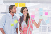 Young man and woman brainstorming together — Stock Photo