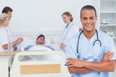 Attractive doctor with arms crossed — Stock Photo