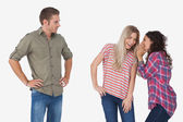 Girls whispering secrets and leaving man out — Stock Photo