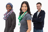 Happy stylish young in a row — Stock Photo