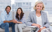 Smiling couple and therapist — Stock Photo