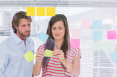 Colleagues pasting sticky note — Stock Photo