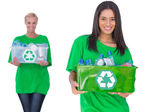 Two enivromental activists holding box of recyclables — Stock Photo