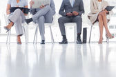Group of well dressed business waiting — Stock Photo