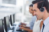 Focus on a smiling call centre agent — 图库照片