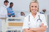 Blonde nurse crossing her arms — Stock Photo