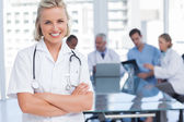 Smiling nurse with arms crossed — Stock Photo