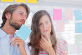 Two colleagues looking at sticky notes — Stock Photo