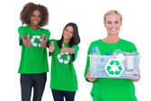 Smiling activist holding recycling box — Stock Photo