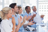 Medical team clapping hands — Stock Photo