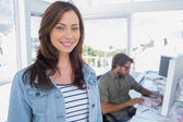 Woman smiling in creative office — Stock Photo