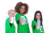 Three smiling enviromental showing matierials — Stock Photo