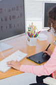 Editor using graphics tablet to do work — Stock Photo