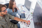 Photo editors choosing thumbnails for final cut — Stock Photo