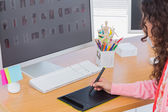 Editor using graphics tablet to edit — Stock Photo