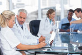 Two doctors using laptop — Stock Photo