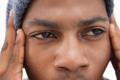 Man in beanie hat looking upset — Stockfoto