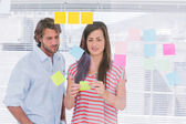 Colleagues reading sticky note — Stock Photo